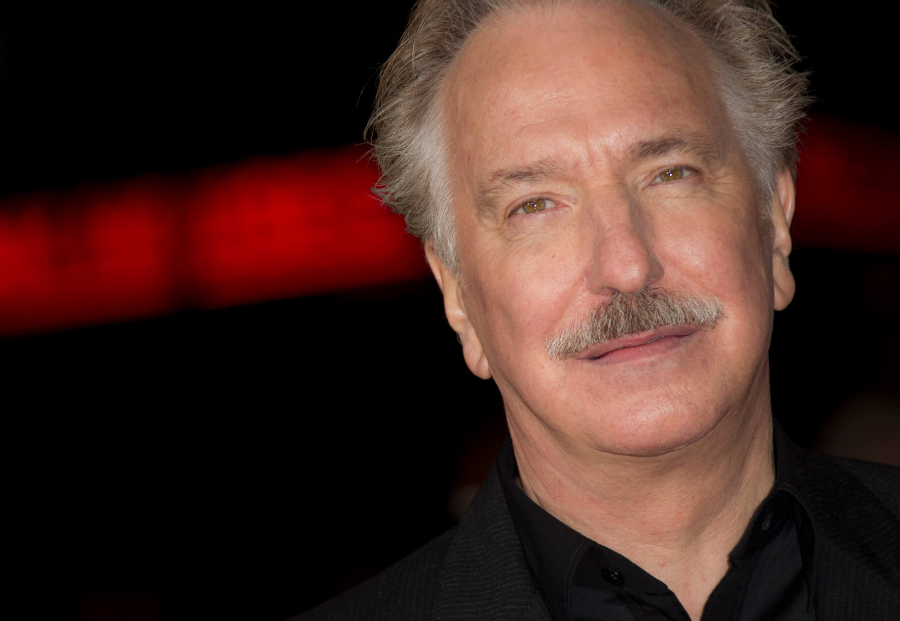 "FILE - In this Wednesday, Nov. 7, 2012 file photo, actor Alan Rickman arrives for the World Premiere of Gambit at the Empire cinema in central London.  British actor Alan Rickman, whose career ranged from Britain's Royal Shakespeare Company to the ""Harry Potter"" films, has died. He was 69.  Rickman's family said Thursday, Jan. 14, 2016 that the actor had died after a battle with cancer.   (Photo by Joel Ryan/Invision/AP, File)"